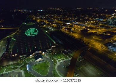 MEMPHIS, TENNESSEE, USA - AUGUST 1, 2018: Aerial night photo Bass Pro Shops at the Pyramid Memphis Tennessee USA