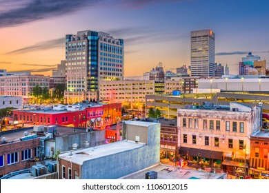 Memphis, Tennessee, USA city skyline over Beale Street at dusk.
