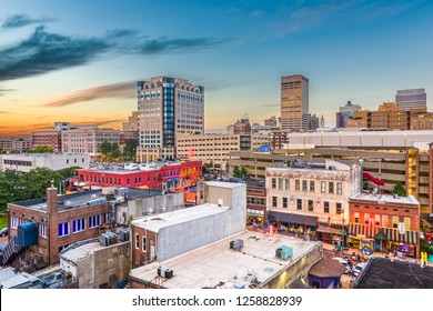 Memphis, Tennessee, USA   downtown city skyline over Beale Street after sunset.