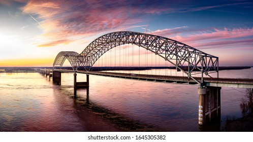 Memphis, Tennessee / USA - February 8, 2020: Iconic Memphis Bridge - Hernando Desoto Bridge on the Mississippi River at sunset. Vibrant colors, striking contrast, modern art photography.