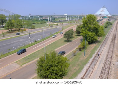 Memphis, TennesseeAugust 25, 2018: Road, bridge, railway and Memphis Pyramid with clear blue sky background.