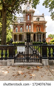 Memphis, Tennessee/USA - June 20, 2019:  Victorian Village - Woodruff Fontaine House Museum front gate with dead leaves scattered on the sidewalk in Memphis, TN