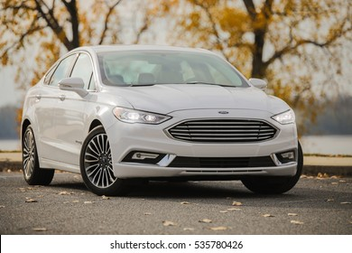 MEMPHIS, TN - DECEMBER 7, 2016: A 2016 FORD FUSION HYBRID TITANIUM. The total system output is rated at 188 horsepower. Fuel economy is estimated at 44 mpg in the city, 41 mpg on the highway