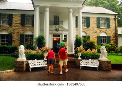 Memphis, TN, USA July 20, 2009 A tour group prepares to enter Graceland, former home of Elvis Presley in Memphis, Tennessee