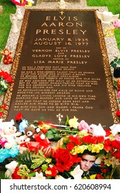Memphis, TN, USA July 20, 2009 The grave Elvis Presley at Graceland in Memphis, Tennessee is adorn with flowers and gifts left by his fans worldwide