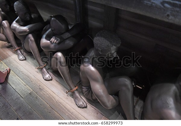 Memphis, TN, USA - June 9, 2017: Sculpture display of black slaves at the National Civil Rights Museum and the site of the Assassination of Dr. Martin Luther King Jr.