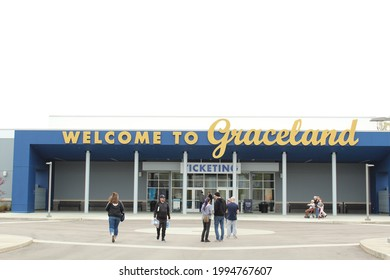 Memphis TN: USA: Mar 27, 2018 – Visitors approach entrance to Graceland, a museum dedicated to Elvis Presley. National Historic Site.
