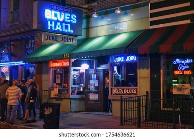 Memphis, TN, USA - September 24, 2019: People congregate outside the Blues Hall and juke joint which offers drinks to go on the famous Beale Street.