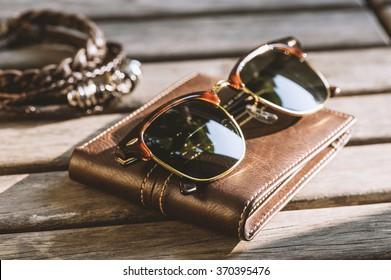 men accessories, closeup brown sunglasses
