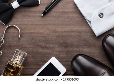 men accessories on the brown wooden table