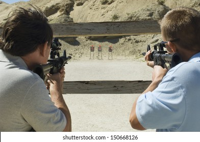 Men aiming rifles at firing range