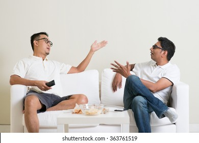 Men arguing. Two male friend disagree to each other and having argument at home. Multiracial people friendship.