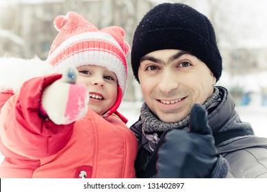 men with baby in winter