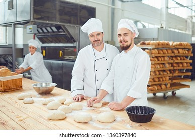Men bakers in the workplace in the bakery