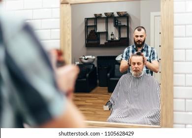 Men in barbershop hair care service
