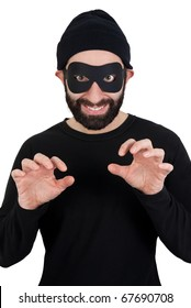 A men with beard dressed as a funny thief (black clothes, black woollen hat, masked eyes) smiling and holding his hands as if ready to steal something while looking straight at camera.