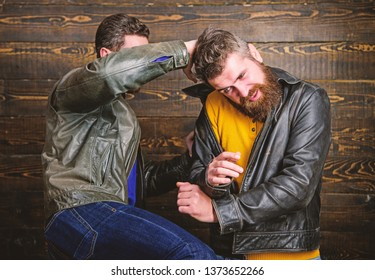Men bearded hipster fighting. Attack and defence. Aggressive hooligan fighting with strong bully man. Street fight concept. Men brutal hooligans wear leather jackets fighting. Physical attack.