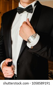 the men in brutal black and bussines clothes with hand watch