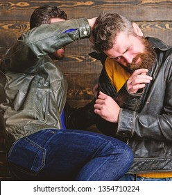 Men brutal hooligans wear leather jackets fighting. Physical attack. Men bearded hipster fighting. Attack and defence. Aggressive hooligan fighting with strong bully man. Street fight concept.