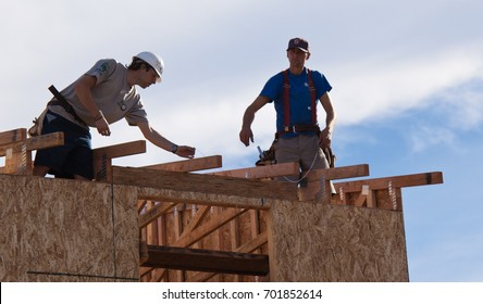 Men build roof for home for Habitat For Humanity For Humanity. El Rincon, Oakland, Calif on Jan 22, 2011