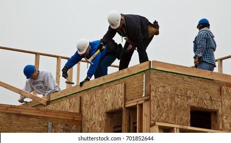 Men build roof for home for Habitat For Humanity. El Rincon, Oakland, Calif on Jan 22, 2011