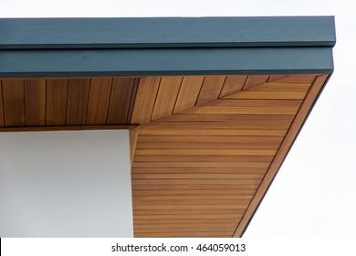 Men build siding Fiber Cement Board under roof