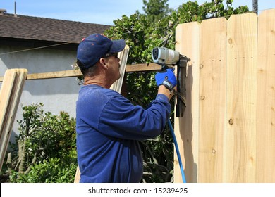 Men building a Fence in garden