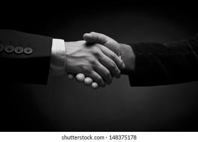 Men of business closing a treatment
