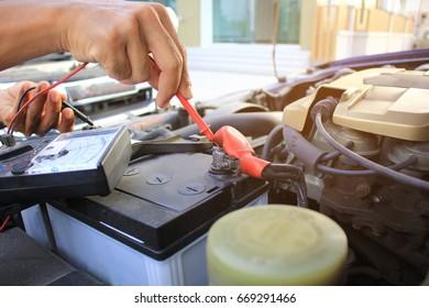 Men checking the circuit of the car, Auto mechanic repairing car