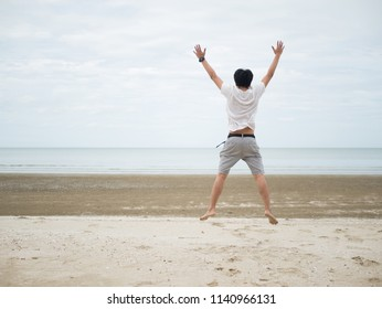 Men are in a cheerful mood. Happy jumping Ready to fight At the beach.