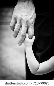 men and child arm black and white