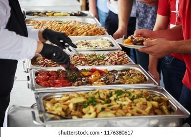 men choosing food at a banquet