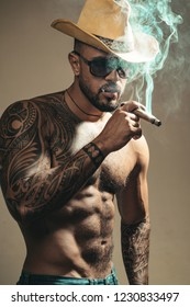 Men with cigars. Man with glasses looking in camera and smoke cuban cigar. Elite cigar store concept