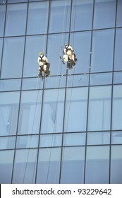Men cleaning windows on a high rise building in Dubai