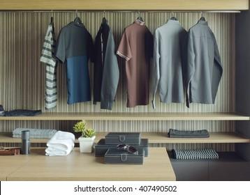 Men cloths in wooden walk in closet