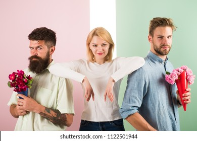 Men competitors with bouquets flowers try conquer girl. Girl likes to be in middle attention. Girl popular receive lot men attention. Love triangle. Woman cunning face has opportunity choose partner.