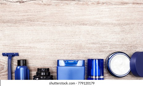 Men cosmetics background. Essential male grooming products on shabby wooden surface with free space for text