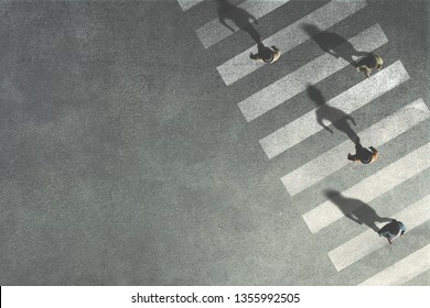 men crossing the street at crossroads