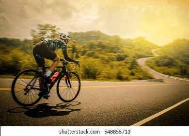 Men cycling mountain road bike in the morning