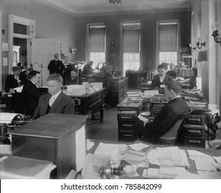 Men at desks in White House Executive Office, Dec. 23, 1908, Washington, D.C. They were working during the transition from Theodore Roosevelts to William Tafts administrations