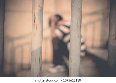 Men desperate to catch the iron prison,prisoner concept,thailand people,Hope to be free,A person guilty are punished.