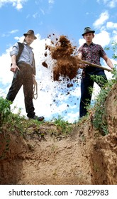 Men are digging with spade