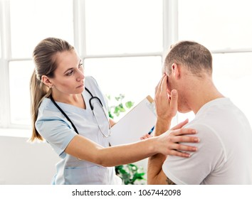 men with doctor having a head problem