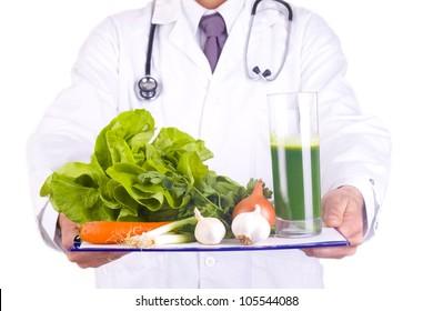 men doctor holding fresh vegetables