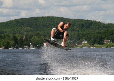 men doing wakeboard at summer