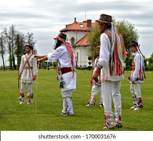 Men dressed in traditional Romanian clothes (ie or ia) performing Whitsuntide dance - old elder dance traditions after Easter Holidays - Dragasani, Dolj / Romania - 5/28/2018