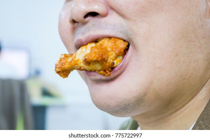 Men are eating fried chicken.