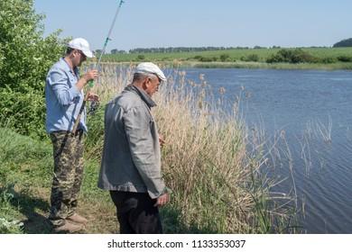 Men enjoying fishing at the pond