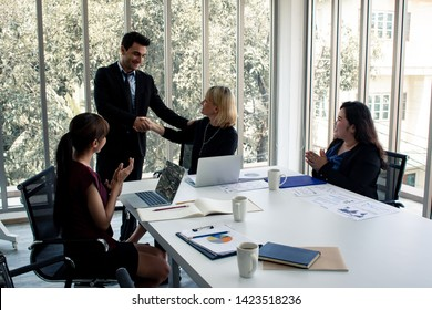Men with explaining the information in meeting room. Concept of meeting room where staff are planning and looking for ways to do business. Concept business in meeting room.