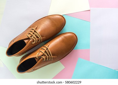 men fashion shoe on color paper background